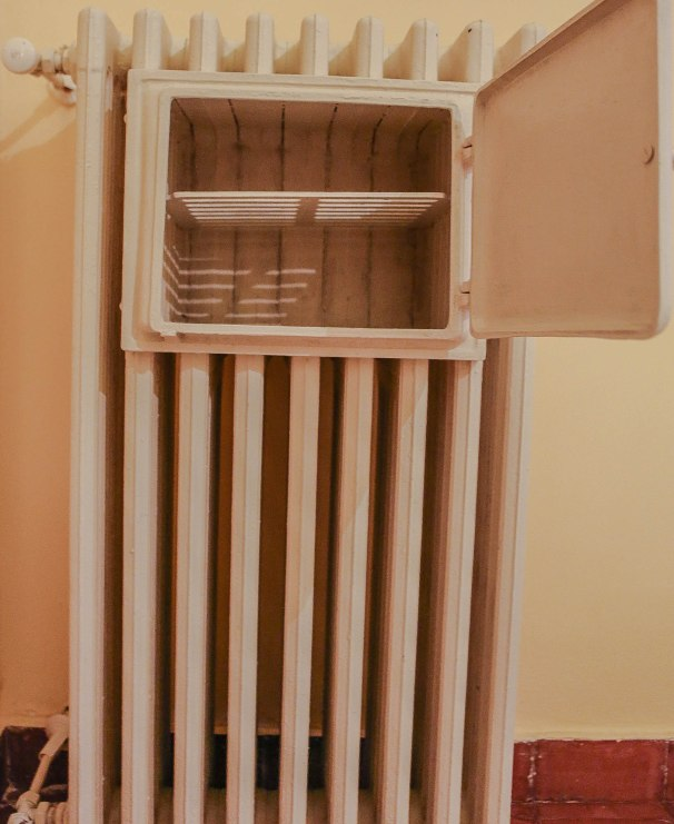 An old fashion towel warmer set into the heater.